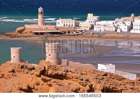 SUR, OMAN: View of Ayjah with watch towers in the foreground