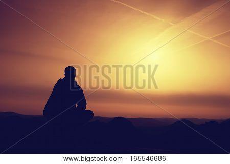 Hiker In Black Sit Alone On Summit. Wonderful Mountains