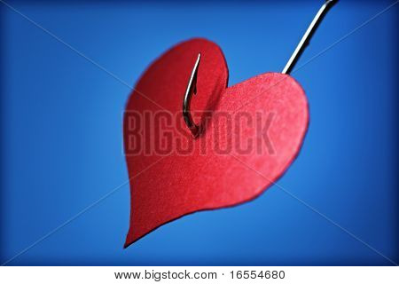 Pierced heart with a hook - concept for lovestruck or broken hearted