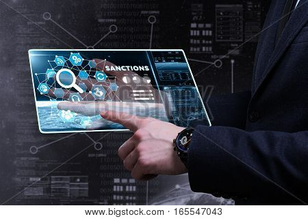 Business, Technology, Internet And Network Concept. Young Business Man Writing Word: Sanctions