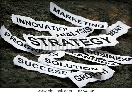Torn newspaper headlines depicting business strategy