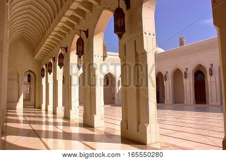 MUSCAT, OMAN: courtyard with arcades at Sultan Qaboos Grand Mosque