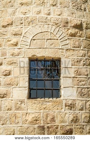 Barred window Montefiore Windmill in Jerusalem Israel