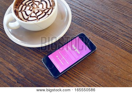SONGKHLA THAILAND - Sep 282016: Apple iPhone with Instagram application on the screen. Instagram is a photo-sharing app for smartphones and mocha coffee