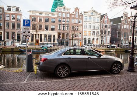 Amsterdam, Netherlands, 11 December 2016 - the power supply plugged into an electric car being charged.
