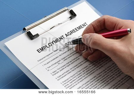 Man filling out an employment agreement contract