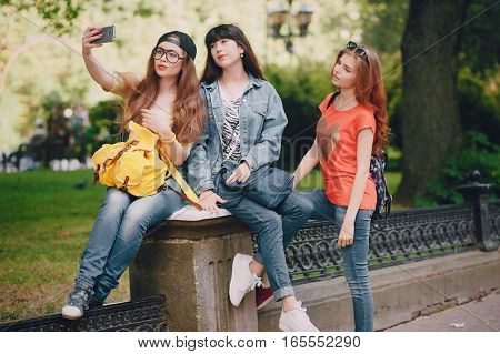 youn girl walking in the park make selfie have fun