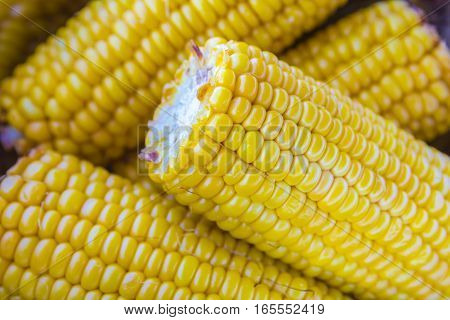 stack of grilled sweet corn on the cob