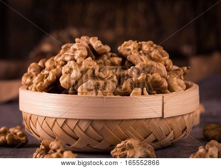 peeled walnuts in a wicker basket .
