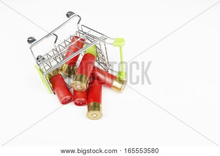 Red hunting cartridges for shotgun in metal shopping trolley. Macro shot.