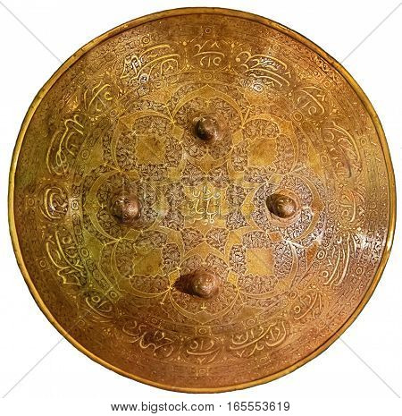 Beautiful ancient shield with inscriptions of Islam on an isolated white background.