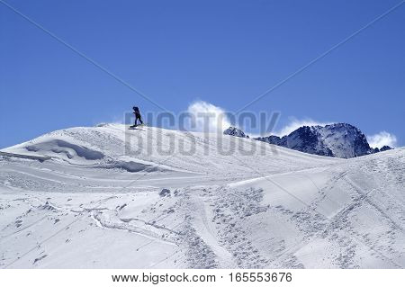 Snowboarder In Terrain Park At Ski Resort On Sun Winter Day