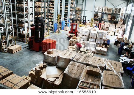 Full warehouse with forklifts and lots of packages poster