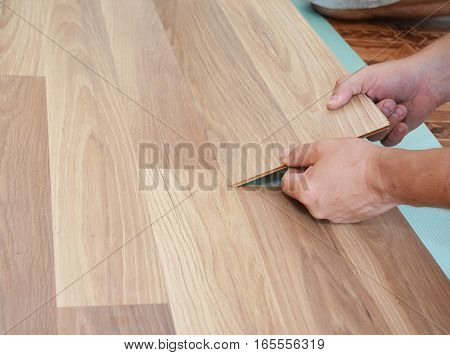 Laminate flooring installation. Installing wooden laminate flooring. Step by Step.