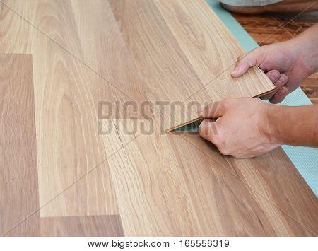 Laminate flooring installation. Installing wooden laminate flooring. Step by Step.