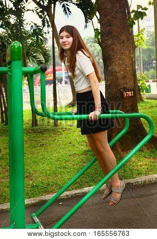teenager girl training in asian park in vietnam