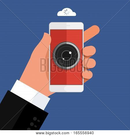 Concept of spying. Hand holding smartphone with camera eye on display. Mobile smart phone in hand on dark background. Flat design, vector illustration