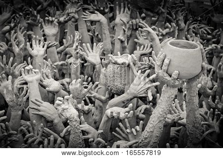 Hands from hell at Wat Rong Khun. Chiangrai province Thailand. Filter effect style This picture is taken on 12/16/2016 about 10.00AM.
