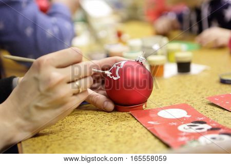 Person Painting Christmas Ball