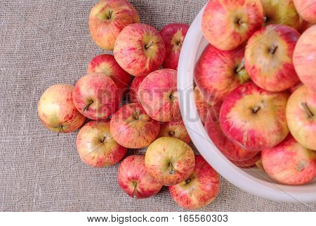 White bucket with red apples. View from above
