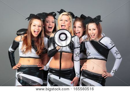 cheerleader team with megaphone, rooting for their team