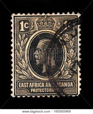 East Africa and Uganda protectorat- CIRCA 1912: A stamp printed in United Kingdom shows portrait king George v, circa 1912