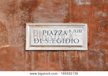 Piazza di S. Egidio, street plate on a wall of old house in Trastevere district, Rome, Italy