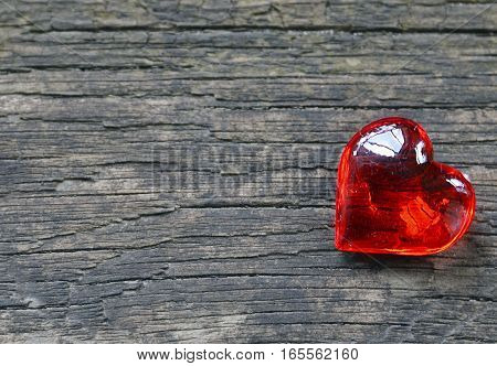 Decorative red heart on old rustic wooden background.Valentine's Day background.Valentine heart.Saint Valentine's Day or Love concept.Selective focus.