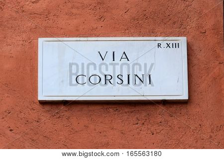Via Corsini, street plate on a wall of old house in Trastevere district, Rome, Italy