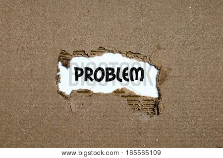 The word problem appearing behind torn paper