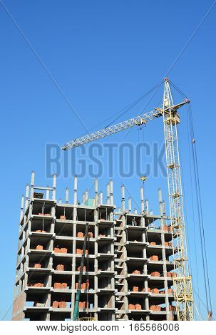 Tower Crane and Building Constructors on Construction Site. Building with two cranes on construction site with builders. Building high rise.