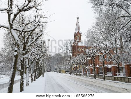 Winter landscape in the city with a lot of snow on the streets.