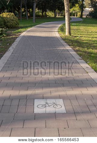 cycleway signposted a ground bikeway for cyclists only. Bike lane between trees in Jardin del Turia in Valencia Spain