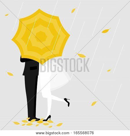 Man and a woman under yellow umbrella