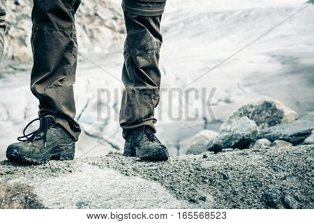 Detail Shot of Hiker's Boots. Rhone Glacier visible in the background.