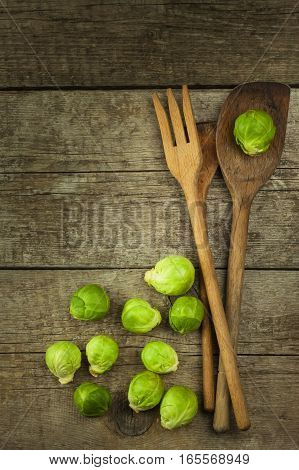 Brussels Sprouts On Old Wooden Table. Homework Fresh Vegetables. Growing Vegetables On The Farm. Pre