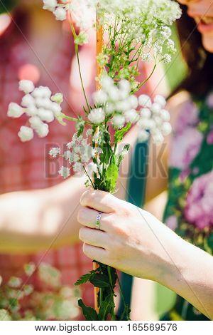 Girl Making Wildflower Bouquet