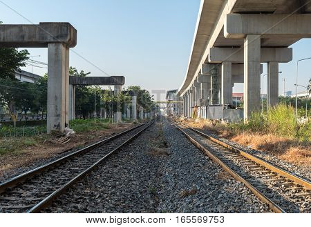 Two railway train under skytrain bts concrete construction