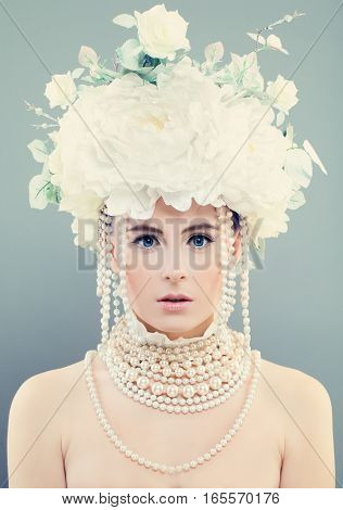Elegant Woman with White Flowers. Young Face Makeup Roses and Jewelry
