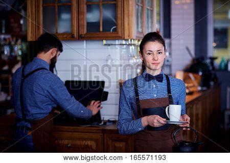 Waitress, a waiter working at cafe bar restaurant.