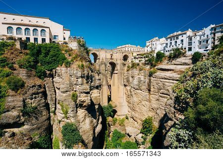 The Puente Nuevo, New Bridge, is newest and largest of three bridges that span the 120-metre , 390 ft, -deep chasm that carries the Guadalevin River and divides city of Ronda, Province Of Malaga, Spain