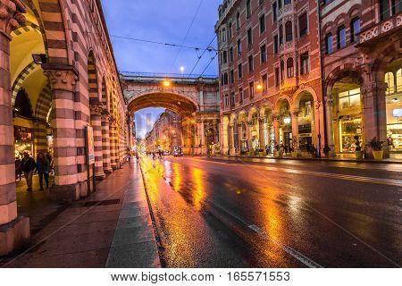 Genoa city center and night main street XX Settebre.