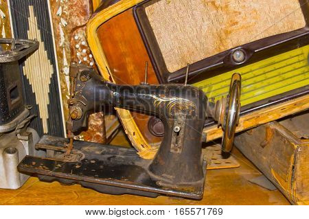 The dump the old stuff - old sewing machine radiogram primus suitcase accordion - retro background