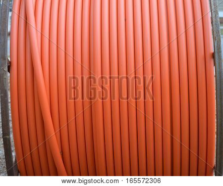 straight shot orange fiber optic cable metal spool