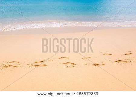 close up Footmark in the Sand on Beach at Thailand