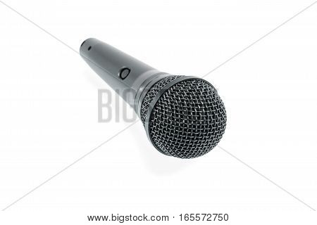 Black microphone with a button lying on a white surface isolated