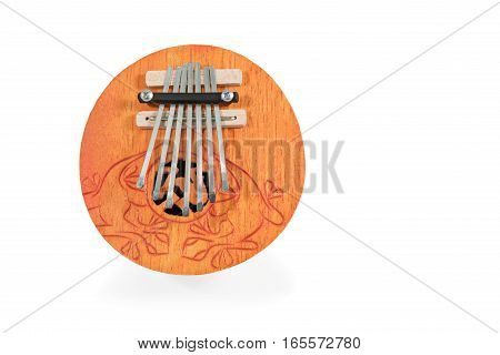 African round played by plucking musical instrument Kalimba, with carved ornaments, isolated on white background