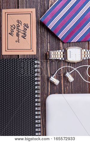 Notebook, striped tie and watch. Father's Day greeting paper. Stylish and useful gifts.