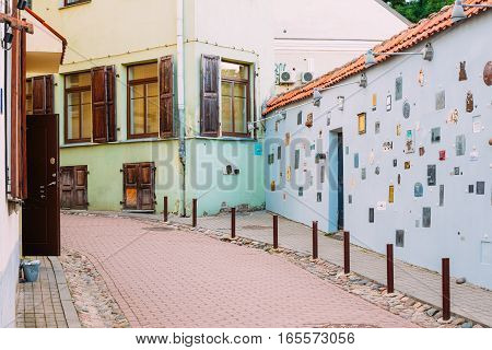 Vilnius, Lithuania - July 7, 2016: Literatu Street - one of the oldest streets in the Old Town of Vilnius, Lithuania. Wall c literary works of art. Literatu Street Wall.