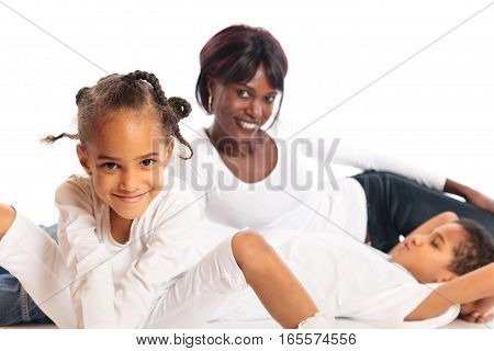 studio shot of african mother and her mixed-race children.